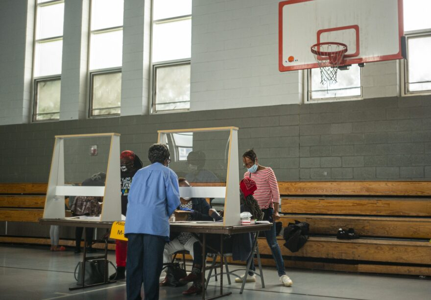Poll workers sit behind plexiglass barriers during primary elections on June 2, 2020 in Philadelphia, Pennsylvania. (Jessica Kourkounis/Getty Images)