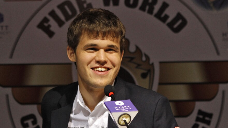 Norway's Magnus Carlsen smiles at a news conference after clinching the FIDE World Chess Championship Friday in Chennai, India, on Friday.