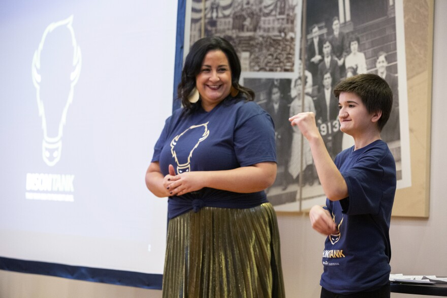 Melissa Yingst (left) and Breannah Medina give opening remarks at Gallaudet University's Bison Tank contest, a college version of the popular TV show <em>Shark Tank</em>, in Washington, D.C.