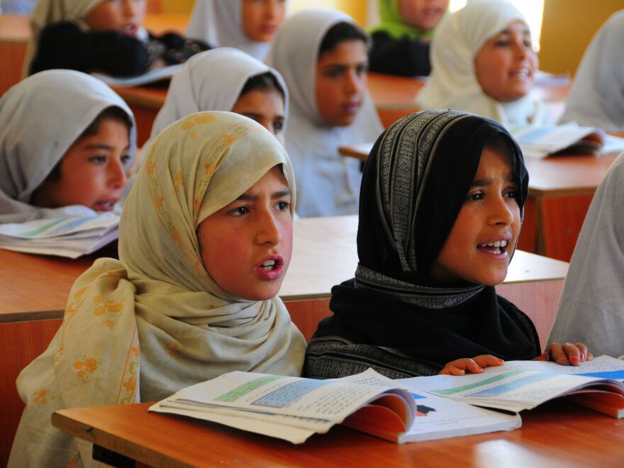 Afghan girls take classes at a refugee school in Afghanistan's Parwan province, on April 3. Under the Taliban, girls were forbidden from receiving an education. Now they account for 40 percent of the country's student enrollment.