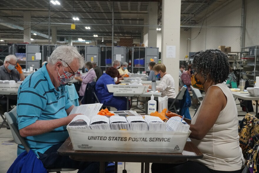 St. Louis County hired 30 bipartisan teams to tally a record amount of absentee and mail-in ballots at the St. Louis County Board of Elections warehouse on July 30.