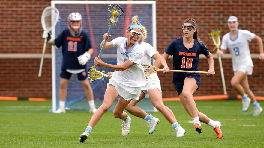Attacker Katie Hoeg, center, is a senior on the University of North Carolina at Chapel Hill women's lacrosse team. She is hoping to continue playing for the Tarheels after graduating this spring.
