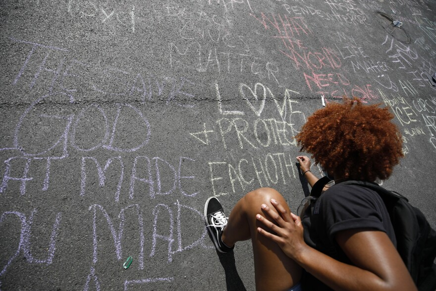 Protesters wrote messages of hope and anger on the new Black Lives Matter Plaza in response to the death of George Floyd and against police brutality in Washington, D.C.