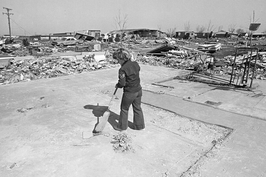 In 1974, a young Xenia, Ohio, resident sweeps the slab of a house that was destroyed in a tornado that struck the town April 3.