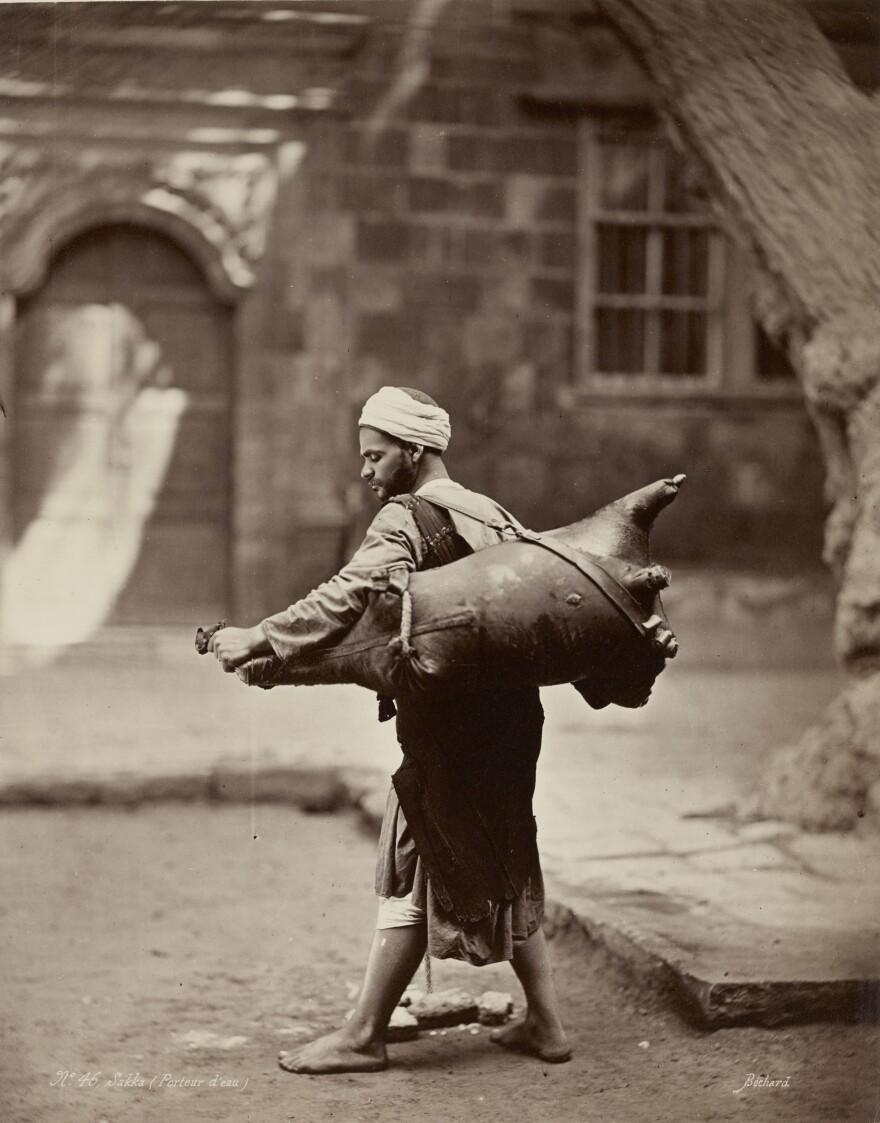 <em>Water Carrier, Cairo</em>, c. 1875.