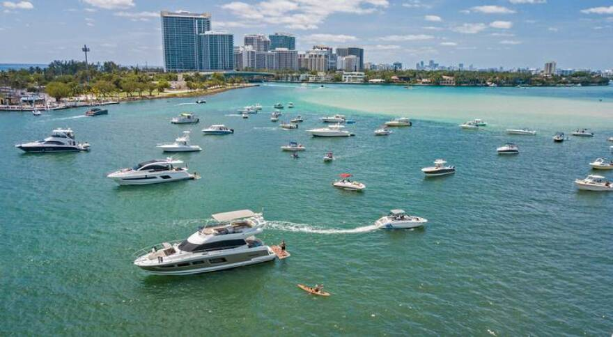 Boaters maintain social distancing off Haulover Park on Saturday, May 2, 2020 as Miami-Dade County opened its parks.