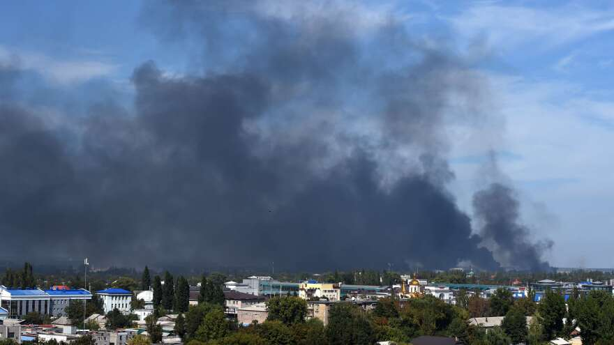 Smoke rises near Donetsk's airport on Sunday amid increased shelling. Pro-Russian forces are trying to dislodge Ukrainian troops. The renewed fighting is testing a fragile cease-fire.