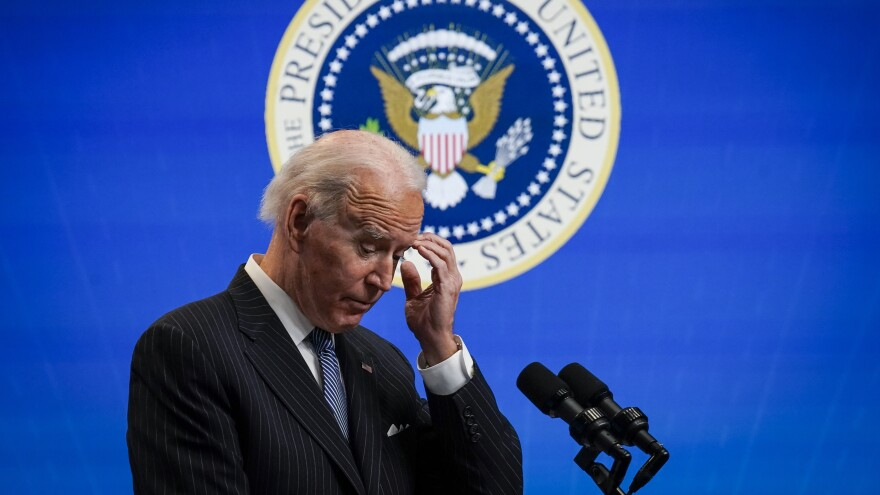 President Biden pauses while speaking after signing an executive order related to manufacturing at the White House Jan. 25. Biden is off to a fast start, but is running into resistance in Congress.