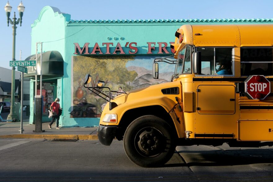 A school bus driver wears a face covering amid a surge of COVID-19 cases in El Paso in El Paso, Texas.