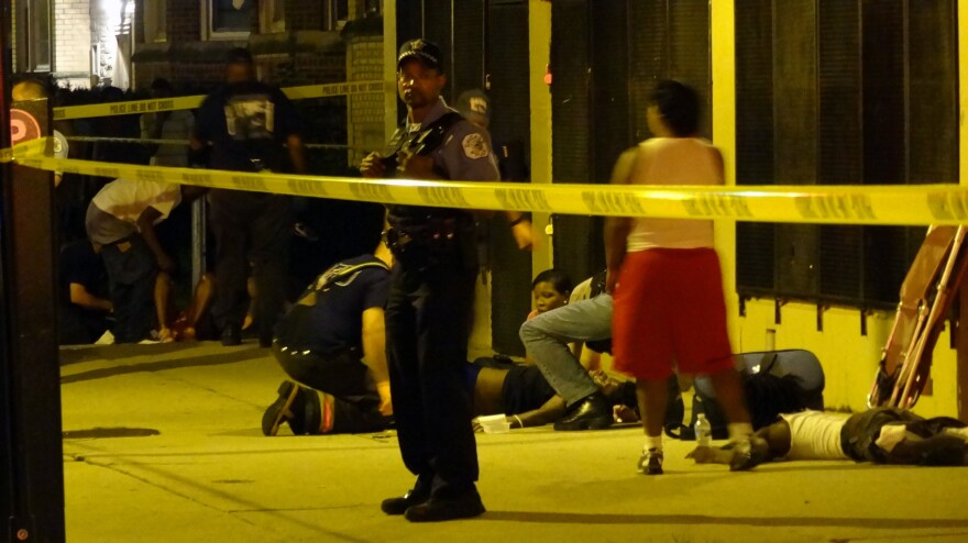 Paramedics treat multiple gunshot victims in Chicago in August.