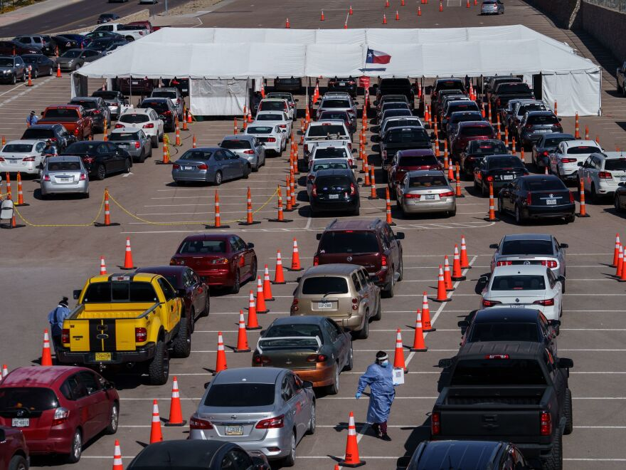 Cars line up at a COVID-19 testing site at the University of Texas at El Paso on Friday. The city has seen a surge in cases in recent weeks, and a curfew is now in effect.