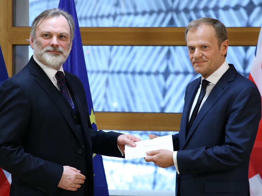British Ambassador to the EU Tim Barrow (left) delivers Prime Minister Theresa May's formal notice of the U.K.'s intention to leave the bloc to European Council President Donald Tusk in Brussels on Wednesday.