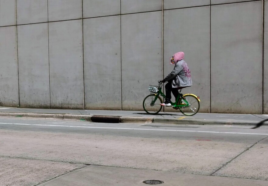 A man rides a Lime rental bicycle in uptown Charlotte in late March. The company has phased out the rental bikes.