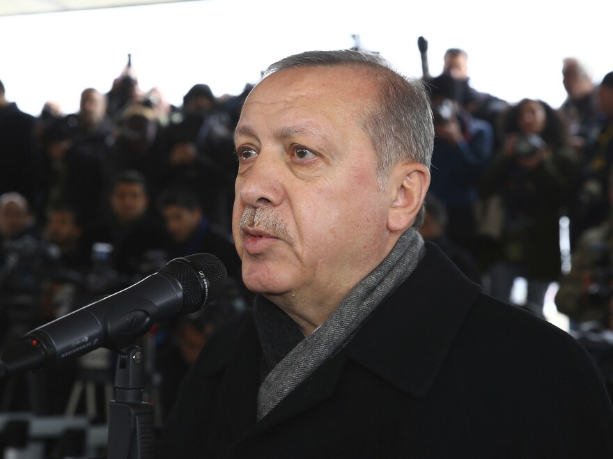 "Turkey's President Recep Tayyip Erdogan speaks in Ankara during the funeral prayers for Sgt. Musa Ozalkan, the first Turkish soldier to be killed in Turkey's cross-border ""Operation Olive Branch"" in northern Syria, on Tuesday."