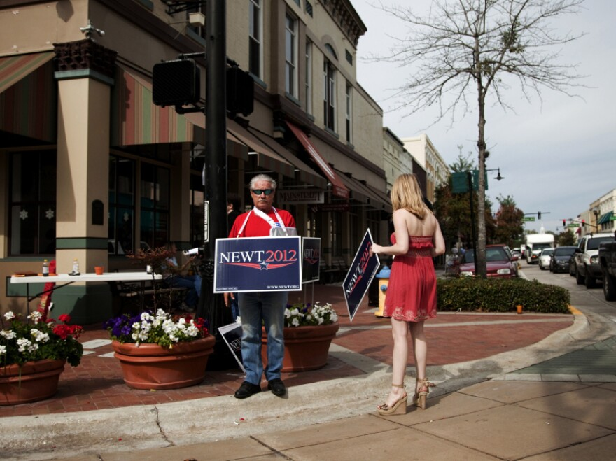 Supporters of Newt Gingrich rally for their candidate Saturday in DeLand, Fla.