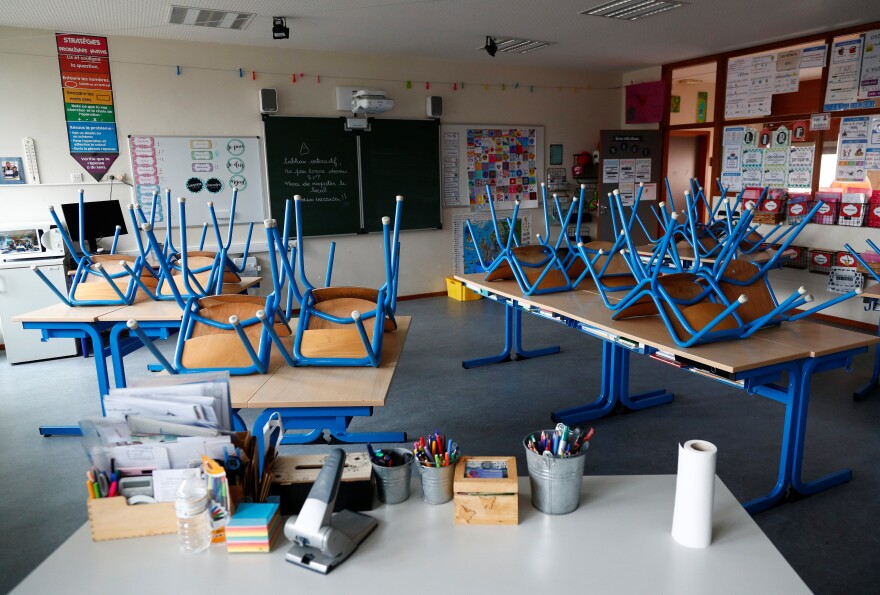 An empty classroom is seen after Belgium's government ordered schools, cafes, restaurants and some shops to close due to the coronavirus disease.