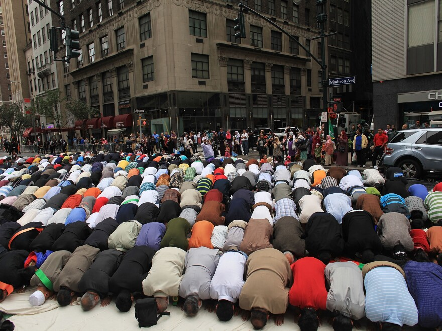 Men pray on the street before the start of the American Muslim Day Parade in 2010 in New York.
