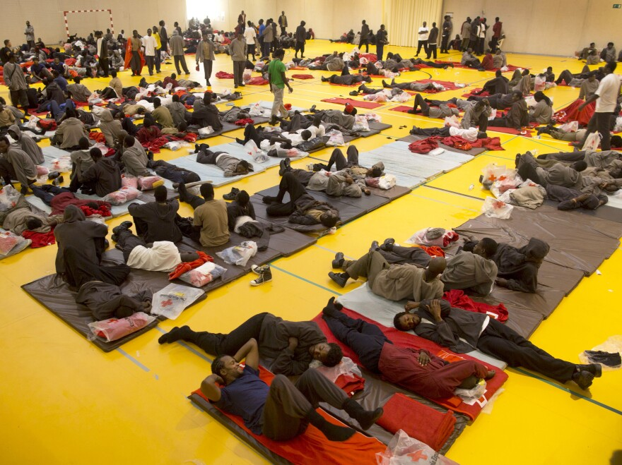 African migrants rest inside a sport center on Wednesday in Tarifa, Spain. Temporary shelters for the migrants are packed beyond capacity.