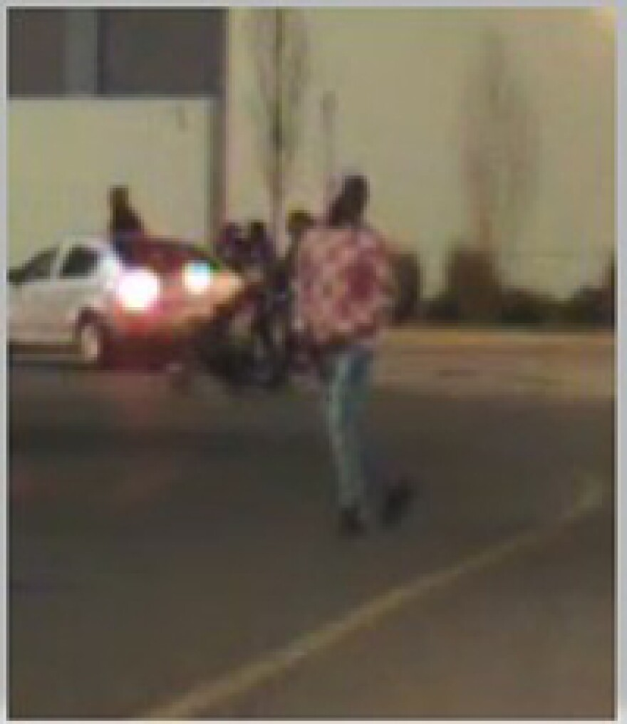 Concord Police say this man in a red and white checkered hoodie is suspect in the shooting outside Concord Mills Saturday night. The image is taken from security video.