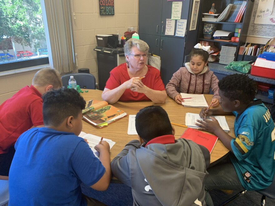 At Palm View Elementary, teacher Karen Ammons teaches reading comprehension to third graders/ Kerry Sheridan/WUSF