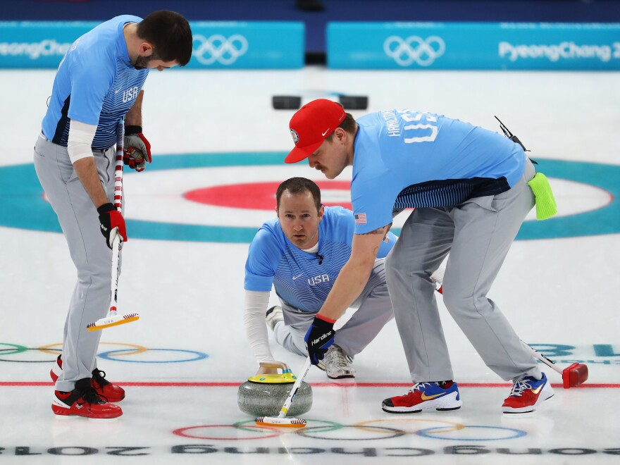 U.S. curlers Matt Hamilton, Tyler George and John Landsteiner compete in the semifinal against Canada Thursday.