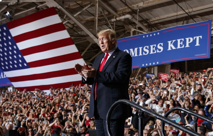 President Trump arrives at a campaign rally in Mesa, Ariz., Friday. He has been holding events around the nation in the final weeks of the midterm campaign, but most of his stops are in states that he won in 2016.