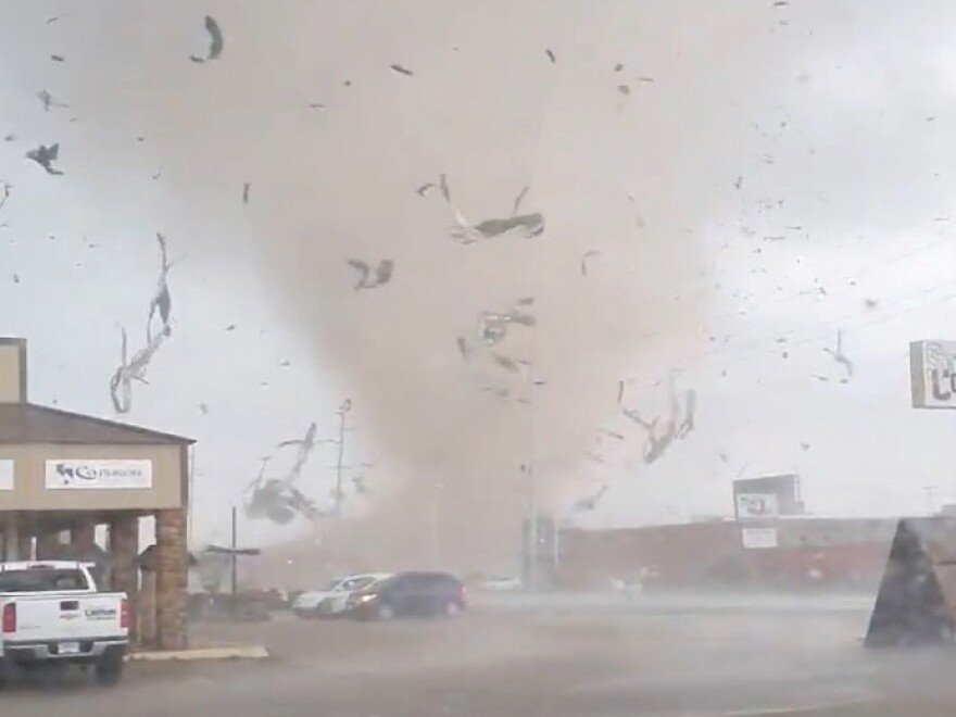 A screen grab from a social media video shows a tornado tearing through Jonesboro, Ark., on Saturday.
