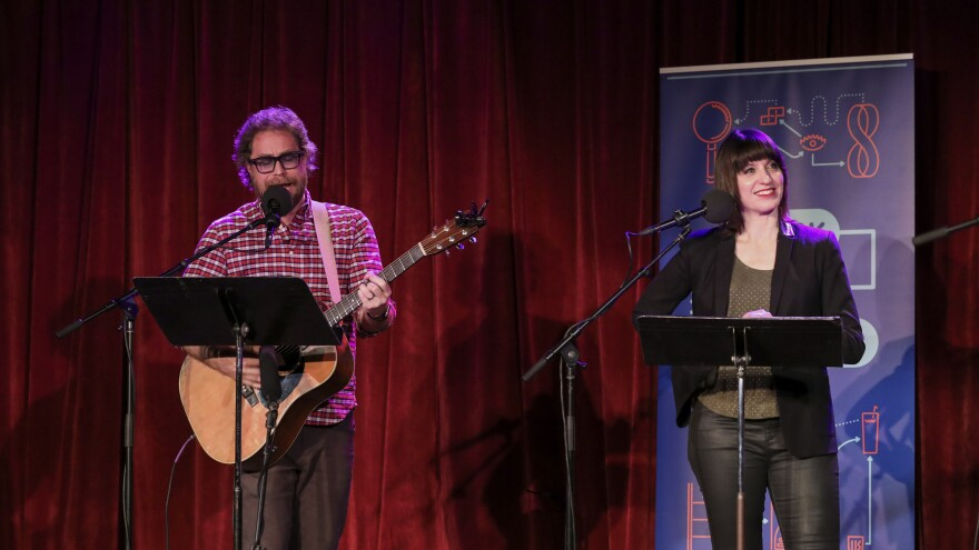 House musician Jonathan Coulton leads a music parody game alongside host Ophira Eisenberg on <em>Ask Me Another</em> at the Bell House in Brooklyn, New York.