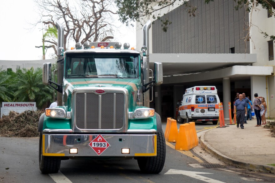 A truck hauling diesel leaves the University of Puerto Rico's Medical Center, which is operating on diesel-powered generators following Hurricane Maria.