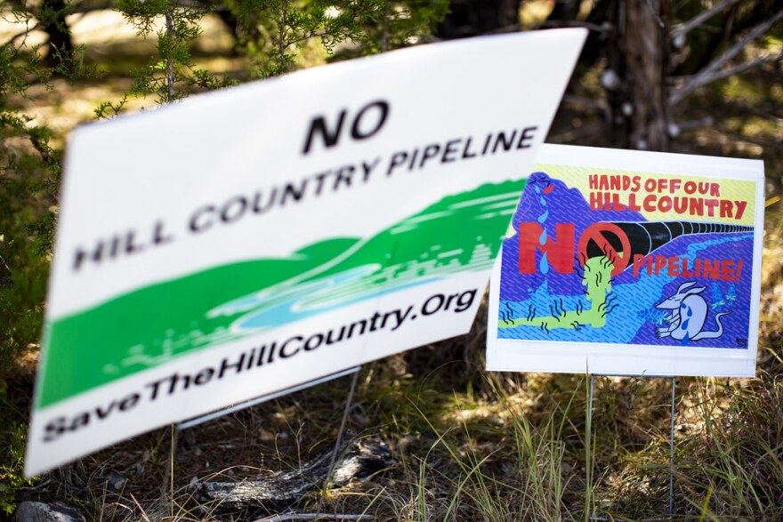 Signs opposing the Kinder Morgan pipeline in Driftwood, Texas.