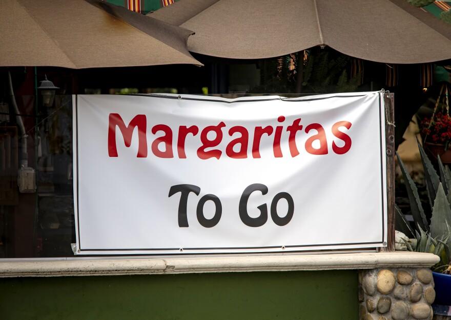 Sign at restaurant offering Margaritias To Go