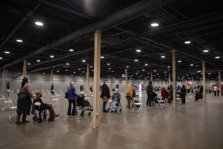Long lines mostly comprising seniors and their caretakers during the first day of the mega vaccine center at Fair Park in Dallas on Jan. 11.