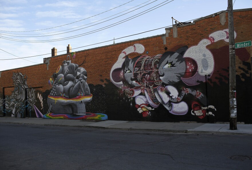 Murals on display across the street from the Red Bull House of Art gallery in Detroit, Mich. After the largest municipal bankruptcy in U.S. history, Detroit hopes outsiders will focus on the city's potential, not the history of conflict and crisis that has cut its population in half since 1960.