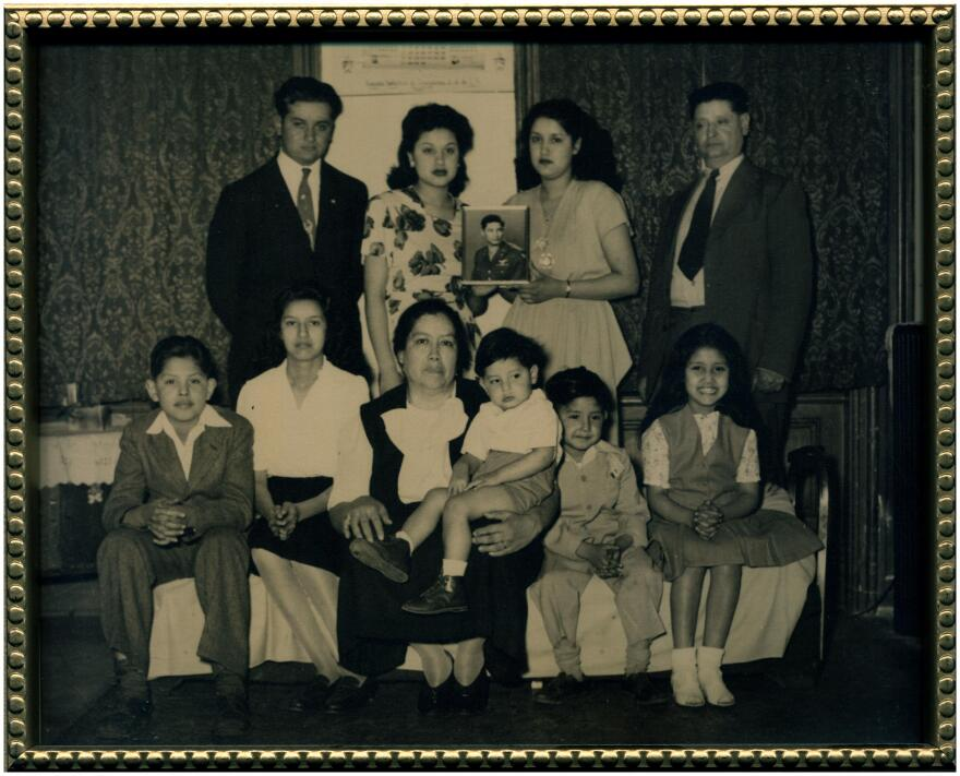 A Zuniga family portrait. Gus Zuniga can be seen in the front row, far left.