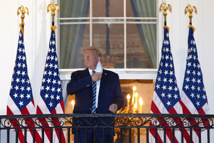 President Trump removes his mask upon return to the White House from Walter Reed National Military Medical Center on Oct. 05, 2020 in Washington, DC. Trump spent three days hospitalized for coronavirus. (Win McNamee/Getty Images)