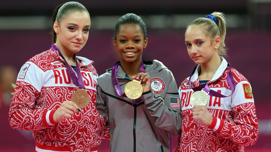 """<strong>Who's The Happiest?</strong> Researchers studied photos of Olympic medalists to learn who is the happiest. Here, bronze medalist Aliya Mustafina of Russia, gold medalist Gabby Douglas of the U.S., and silver medalist Victoria Komova of Russia pose after the <a href=""""http://www.npr.org/blogs/thetorch/2012/08/02/157797366"""">all-around gymnastics final</a>."""