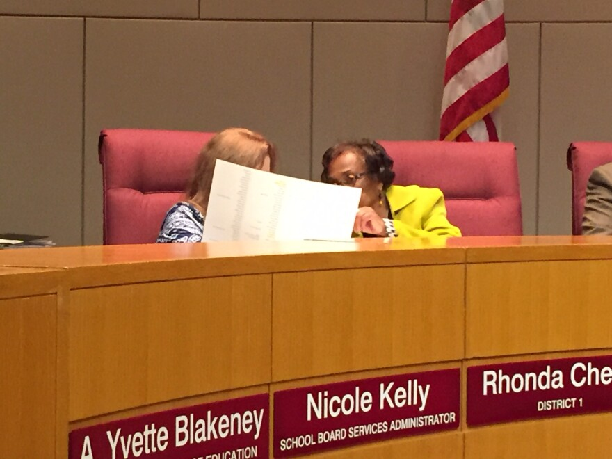 CMS board members Rhonda Cheek (left) and Ruby Jones discuss the names on the equity committee ballot.