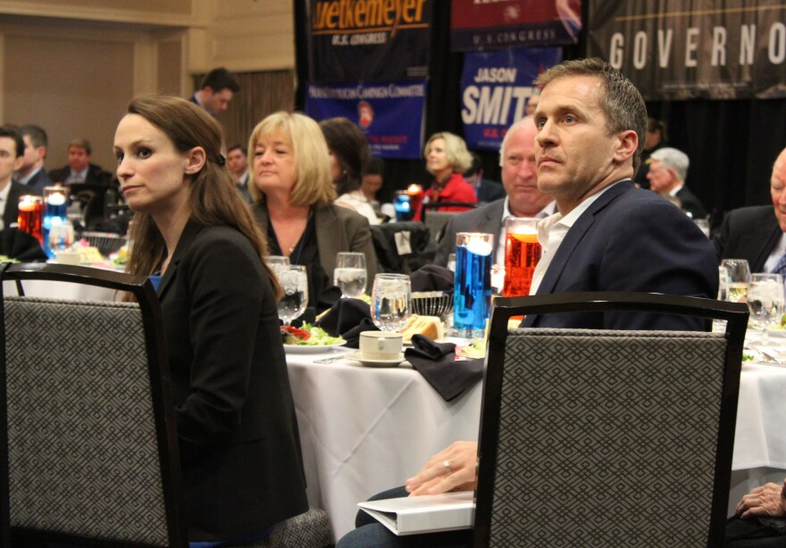GOP gubernatorial candidate Eric Greitens and his wife Sheena listen to speeches during the Lincoln Day banquet in Maryland Heights.