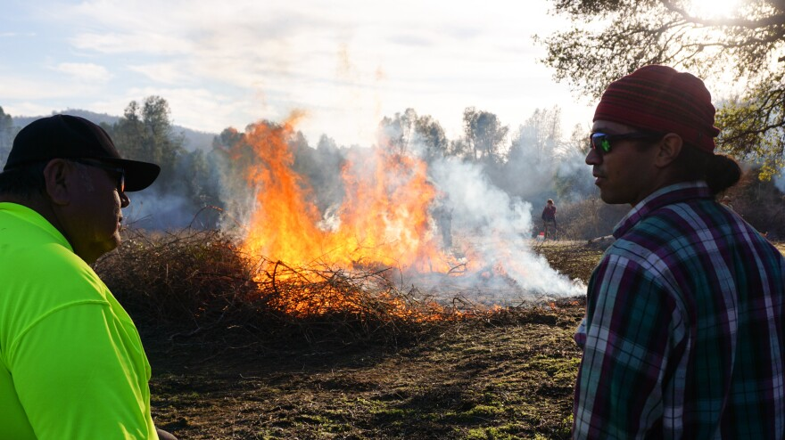 Ron Goode and Ray Gutteriez keep an eye on a burning sourberry bush.