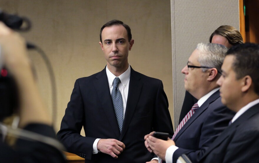 Texas Secretary of State David Whitley, left, arrives for his confirmation hearing in Austin, Texas, on Feb. 7, 2019.