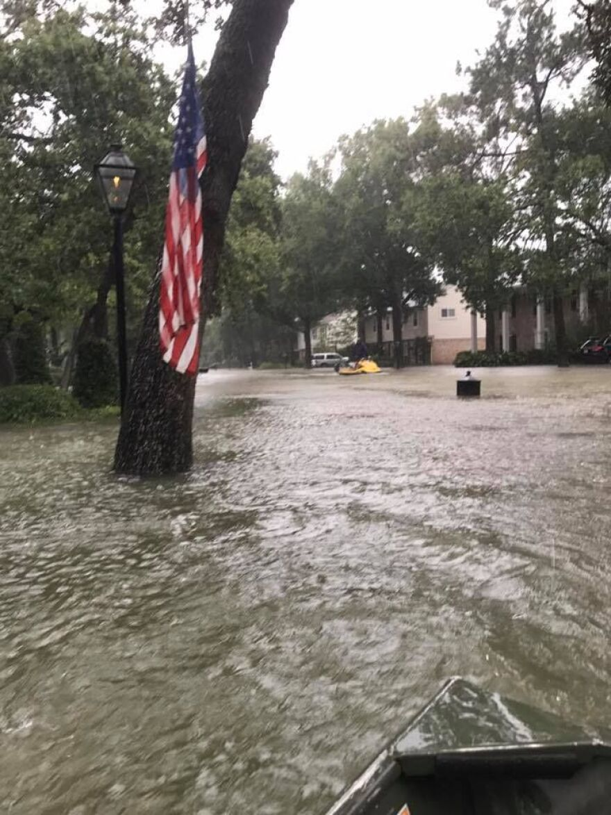 A photo of a flooded Houston neighborhood taken from a rescue boat