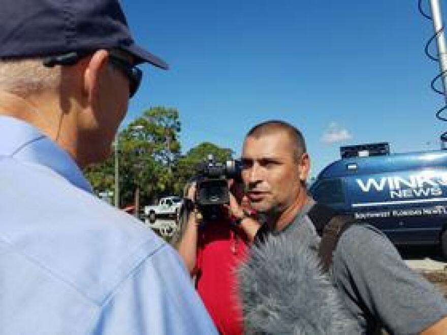Luis Arrango (r), a Bonita Springs resident, talks to Governor Rick Scott (l) about his flooded neighborhood.