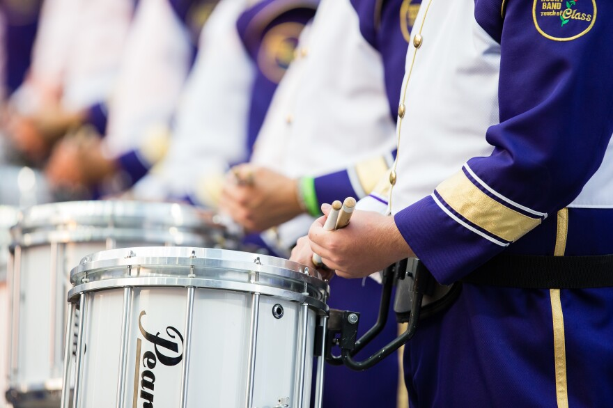 Dozens of members of the University of Washington marching band, shown here in 2017, were transported to hospitals after a bus overturned on Thursday.
