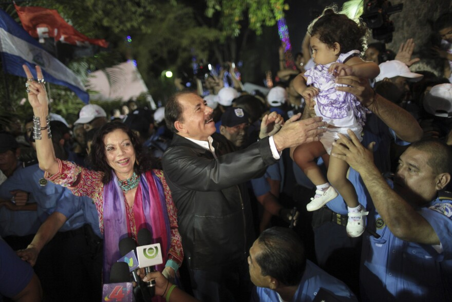 Nicaragua's President Daniel Ortega (center), accompanied by his wife Rosario Murillo, greets supporters in 2011. She has long been a prominent figure, and now Ortega has made her his vice presidential running mate as he seeks a third term in Sunday's election.