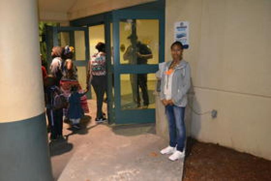 Porcha McIntosh waits outside the door of the emergency room at Broward Health Medical Center in Fort Lauderdale. For hours, she wasn't able to get inside to be with her newborn, who was in the neonatal intensive care unit.