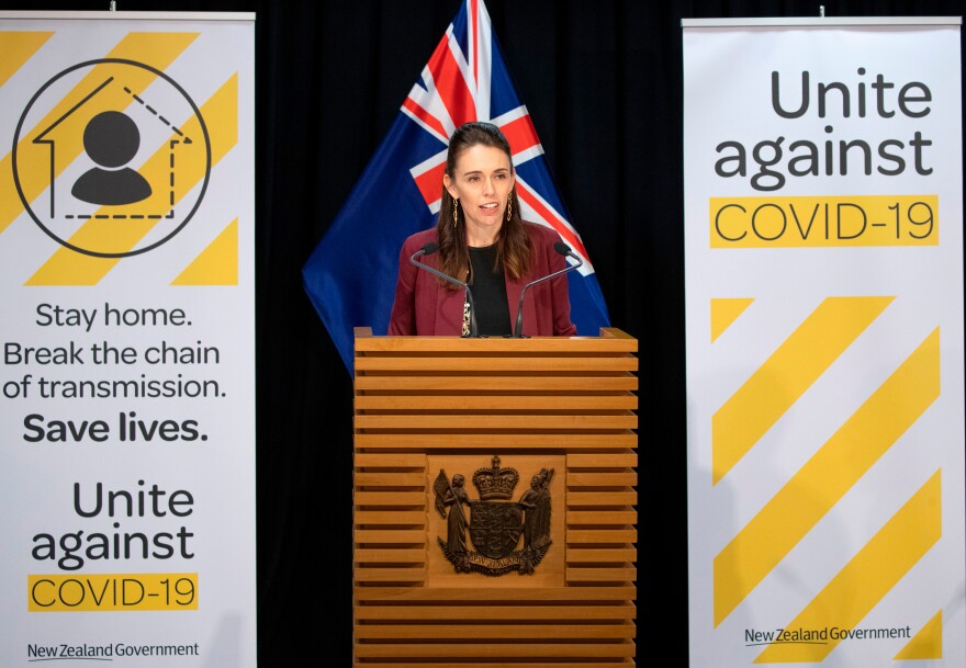 Jacinda Ardern, the prime minister of New Zealand, briefs the media on COVID-19. She issued a call for New Zealanders to protect one another from the health threat.