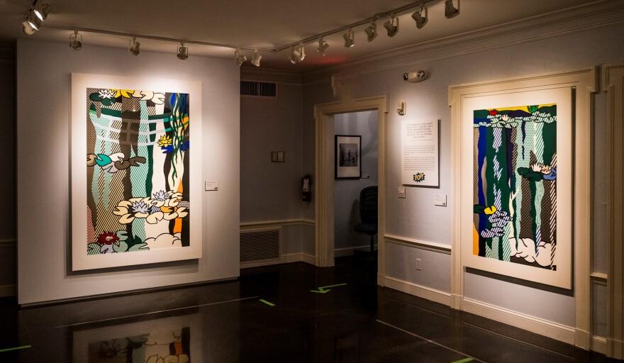 Two prints by artist Roy Lichtenstein hang in a gallery.