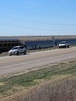 Cars are overturned at the site of Monday's Amtrak train derailment.