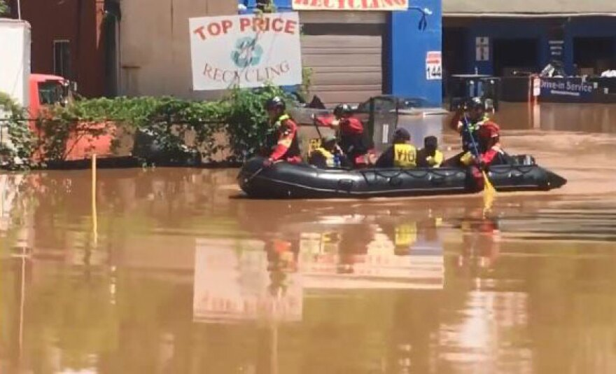 The Charlotte Fire Department responds to a business in Northeast Charlotte that has flooded.