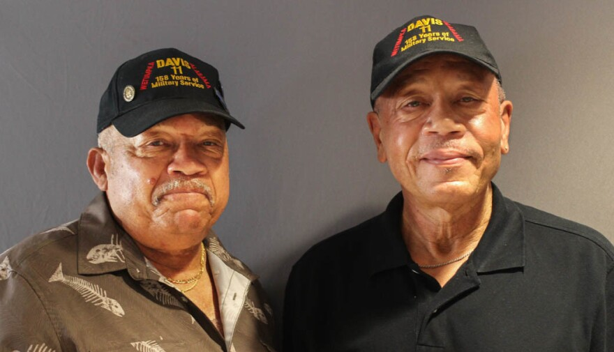 """Brothers Lebronze Davis, left, and Arguster Davis last month during their StoryCorps interview in Birmingham, Ala. """"Daddy taught us all how to do the right thing and wanted us to do the right thing,"""" Lebronze says."""